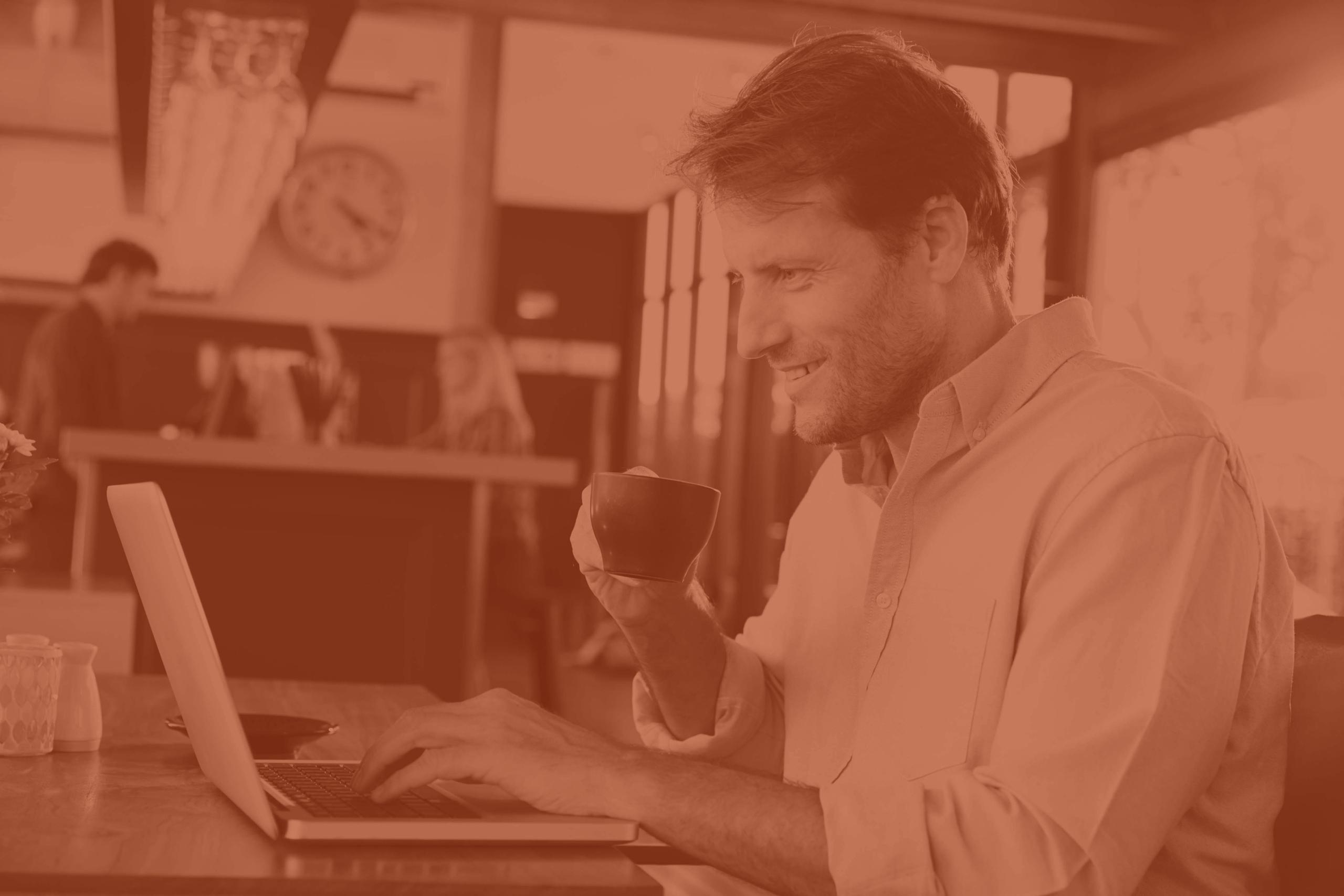 businessman at laptop with coffee